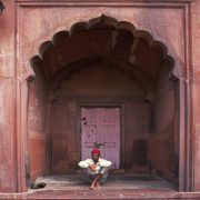 India Old Dehli Jamia Mosque Man Sitting In Doorway