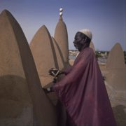 Muadhin on top of Mopti Mosque, Mali